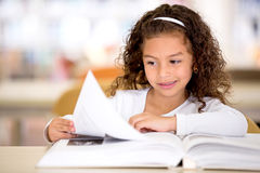 Schoolgirl at the library Royalty Free Stock Images
