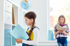 Schoolgirl in library stock photo