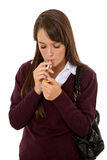Schoolgirl lighting a cigarette Stock Photos