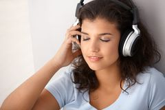 Schoolgirl listening music eyes closed Stock Images