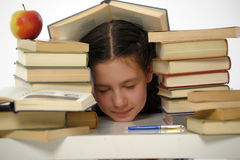 Schoolgirl littered with books Royalty Free Stock Photos
