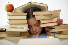 Schoolgirl littered with books Stock Photography