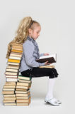 Schoolgirl and a lot of books Stock Image