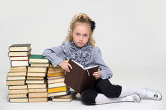 Schoolgirl and a lot of books Stock Photo