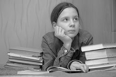 Schoolgirl with a lot of books Royalty Free Stock Image