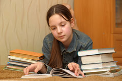 Schoolgirl with a lot of books Stock Image