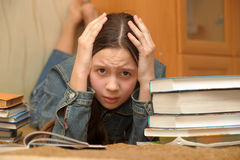 Schoolgirl with a lot of books Stock Photo