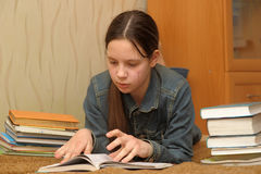 Schoolgirl with a lot of books Stock Photography