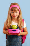 Schoolgirl with lunch box and apple Royalty Free Stock Photos