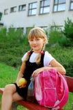 Schoolgirl during lunch break Stock Images