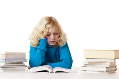 Schoolgirl lying on floor doing homework Stock Images
