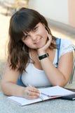Schoolgirl is making notes Stock Image