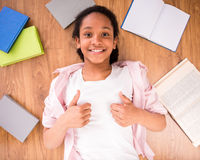 Schoolgirl making thumbs up Stock Images