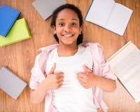 Schoolgirl making thumbs up Stock Images
