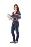 Schoolgirl med böcker och hörlurar med mikrofon Arkivbilder