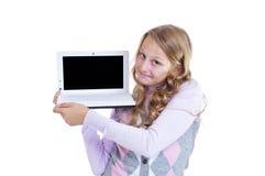 Schoolgirl med henne netbook Royaltyfri Bild