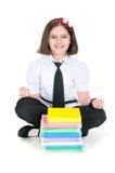 Schoolgirl meditates Royalty Free Stock Photo