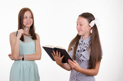 Schoolgirl meets homework Royalty Free Stock Images