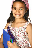 Schoolgirl of mix ethnicity holding a blue folder. Young schoolgirl of mix ethnicity holding a blue folder and files with pens and markers, isolated Royalty Free Stock Images