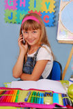 Schoolgirl with mobile phone Royalty Free Stock Photo
