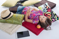 Schoolgirl with a mobile phone, lying on the floor Stock Photography