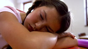 Schoolgirl napping at desk in school stock video footage