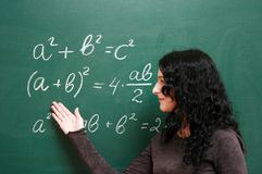 Schoolgirl near the blackboard Stock Images