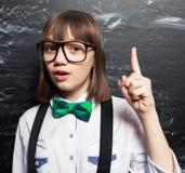 Schoolgirl near blackboard Royalty Free Stock Image