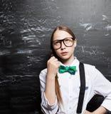Schoolgirl near blackboard Stock Photography