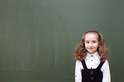 Schoolgirl near a Chalkboard Royalty Free Stock Image