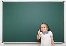 Schoolgirl near school board Royalty Free Stock Image