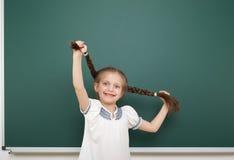 Schoolgirl near school board Royalty Free Stock Photos