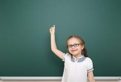 Schoolgirl near school board Stock Photos