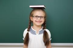Schoolgirl near school board Stock Photography