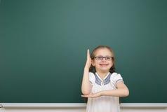 Schoolgirl near school board Royalty Free Stock Photography