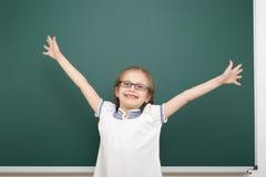 Schoolgirl near school board Stock Image