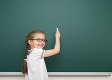Schoolgirl near school board Royalty Free Stock Images