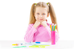 Schoolgirl near the table Royalty Free Stock Photos