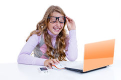 Schoolgirl with netbook and mobile phone Royalty Free Stock Photos