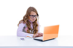 Schoolgirl with netbook and mobile phone Royalty Free Stock Photography