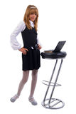 Schoolgirl And Notebook On Chair. Royalty Free Stock Photography