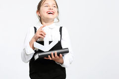 Schoolgirl with notebook. Royalty Free Stock Photography