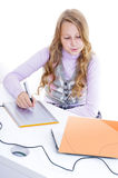 Schoolgirl painting with the digitizer Stock Photos