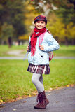 Schoolgirl in park Royalty Free Stock Photography
