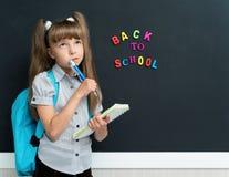 Schoolgirl with pen Stock Image