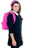 Schoolgirl with pink backpack Stock Image