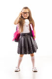 Schoolgirl with pink satchel  in glasses holding Royalty Free Stock Images