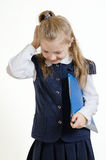 The schoolgirl with the plastic folder. The girl of 9 years in a school uniform with the blue plastic folder for documents poses in studio royalty free stock images