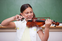 Schoolgirl playing the violin Royalty Free Stock Photography