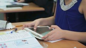 Schoolgirl plays in games using computer tablet stock video footage